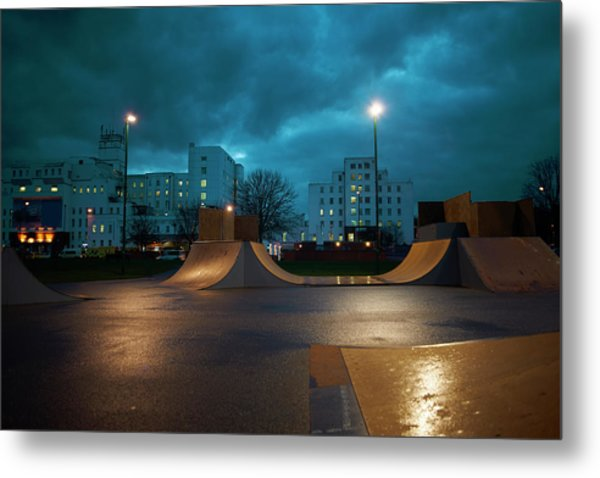 Cityscape And Skateboard Park At Night Metal Print by Peter Muller