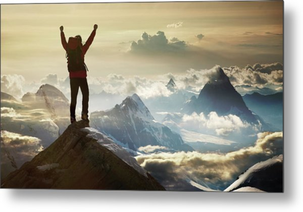 Climber Standing On A Mountain Summit Metal Print by Buena Vista Images