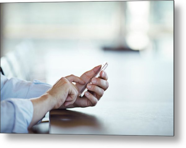 Close-up Of Hands Scrolling On Phone Metal Print by Klaus Vedfelt