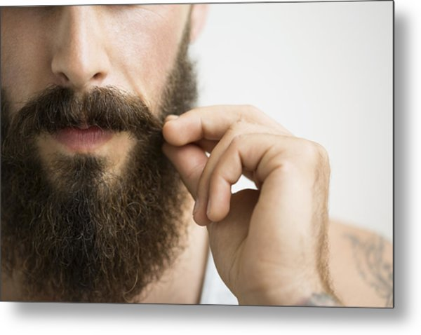 Close Up Of Man Touching Mustache Metal Print by Hero Images