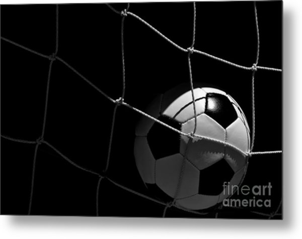 Closeup Of Soccer Ball In Goal Metal Print