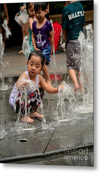 Clothed Children Play At Water Fountain Metal Print
