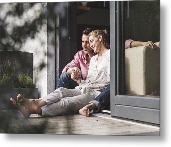 Content Mature Couple Relaxing Together At Open Terrace Door Metal Print by Westend61