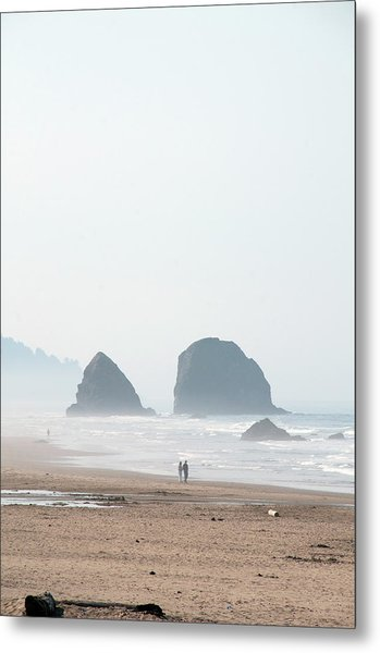 Couple Walking On Rocky Beach Metal Print