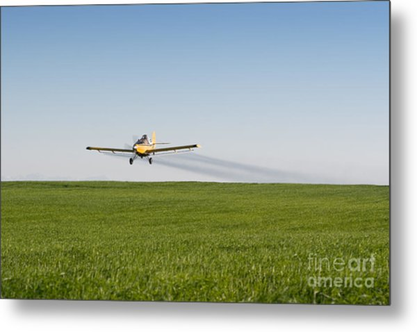 Crop Duster Airplane Flying Over Farmland Metal Print