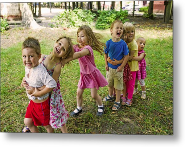 Cute Children Playing At Park Metal Print by UygarGeographic