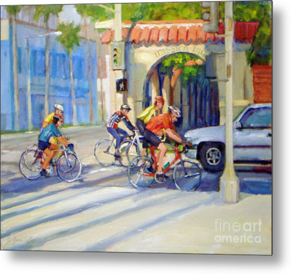 Cycling Past The Archway Metal Print