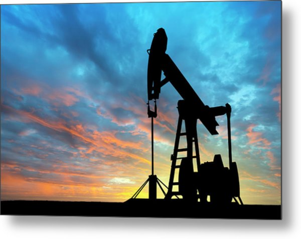 Dawn Over Petroleum Pump Metal Print