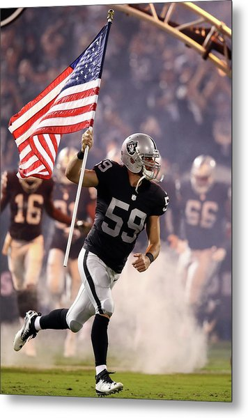 Denver Broncos V Oakland Raiders Metal Print by Ezra Shaw