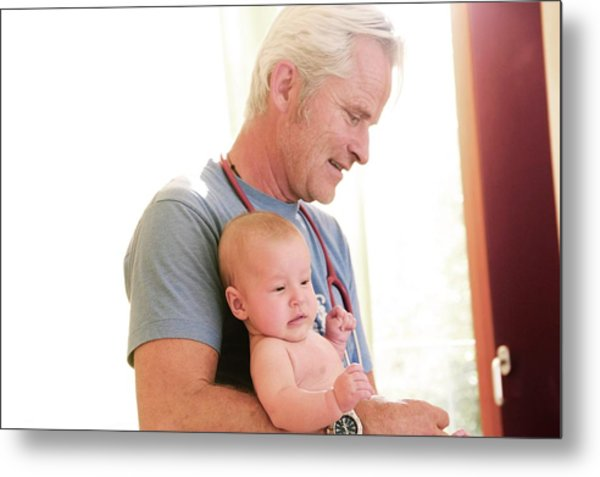 Doctor Holding Baby Metal Print