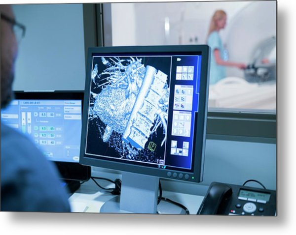 Doctor Looking At Mri Scans On Monitor Metal Print by Science Photo Library