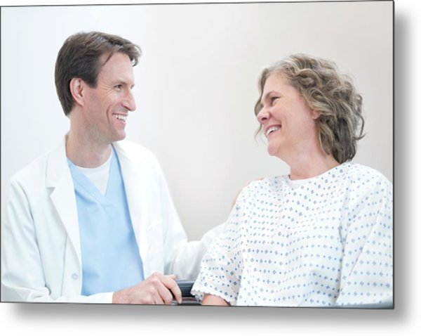 Doctor Smiling At Woman Patient Metal Print by Science Photo Library