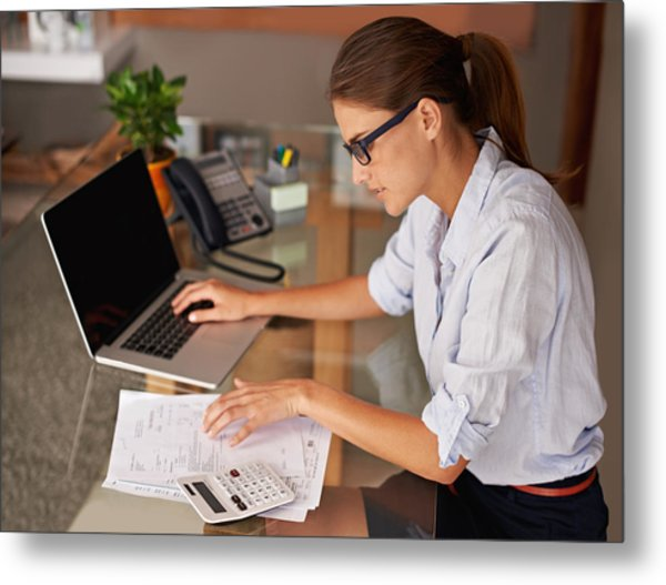 Doing Her Work At Home Metal Print by PeopleImages