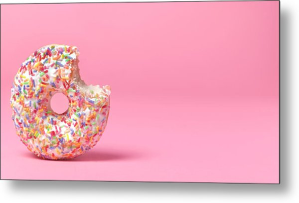 Doughnut On Pink With Bite Out Metal Print by Peter Dazeley