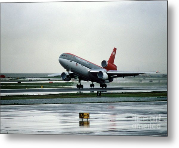 Douglas Dc-10-40 Taking Off In The Rain Metal Print