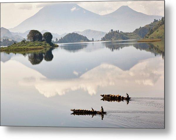Dugout Canoe Floating On Lake Mutanda Metal Print