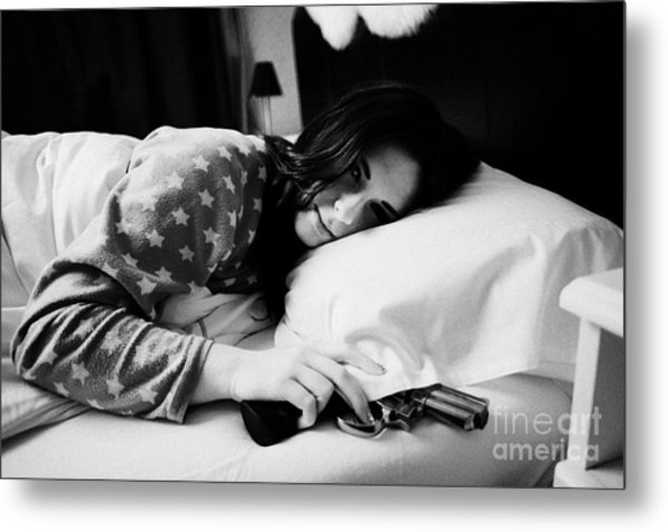 Early Twenties Woman Waking With Hand On Handgun Under Pillow At Night In Bed In A Bedroom Metal Print by Joe Fox