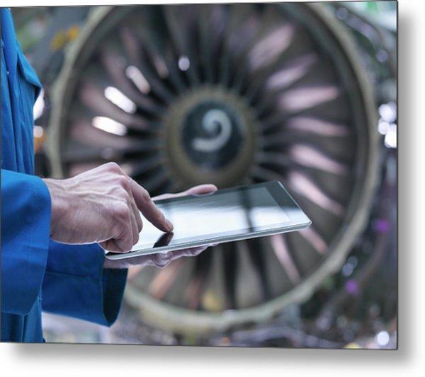 Engineer Using Digital Tablet In Front Metal Print by Monty Rakusen