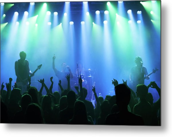 Enjoying Every Song The Band Plays Metal Print by Yuri arcurs