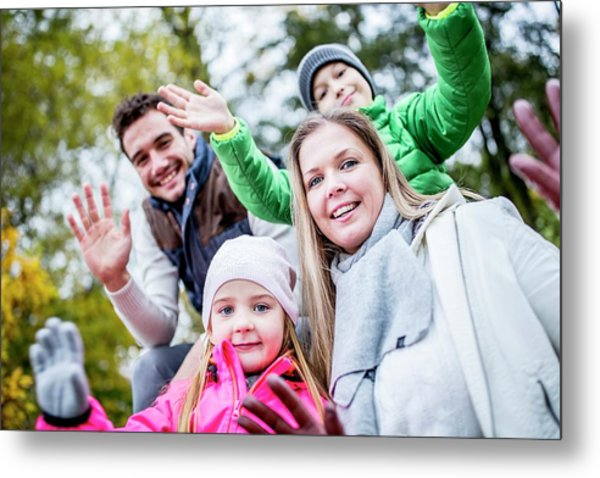 Family Waving Hands Metal Print by Science Photo Library