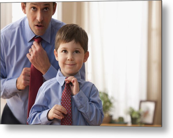 Father And Son Fixing Ties Together Metal Print by SelectStock