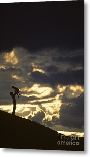 Father Holding Daughter Above His Head Along Hillside Silhouette Metal Print