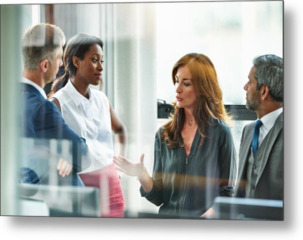Female Business Executive Leading Team Meeting Metal Print by 10'000 Hours
