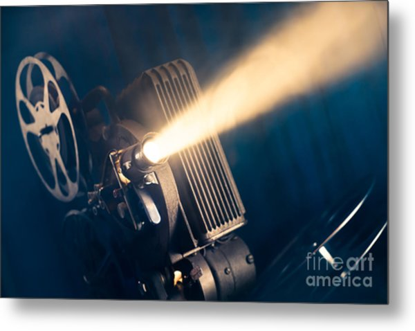 Film Projector On A Wooden Background Metal Print by Fer Gregory