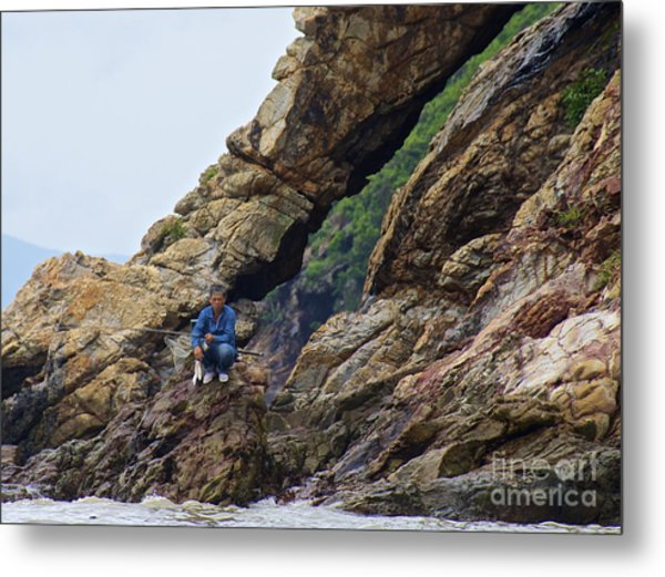 Fisherman On Rocks  Metal Print