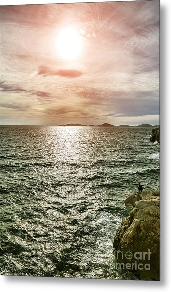 Fisherman On The Cliff At Sunset Metal Print by Pier Giorgio Mariani