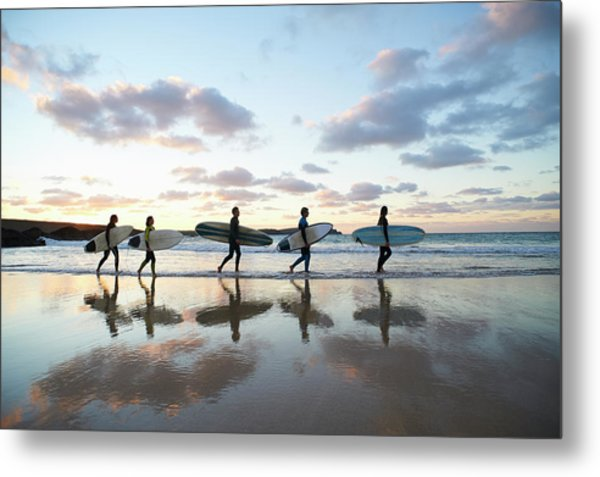 Five Surfers Walk Along Beach With Surf Metal Print by Dougal Waters