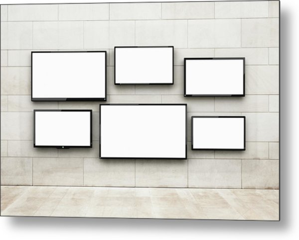 Flat Screens Hanging On A Wall Metal Print by Jorg Greuel