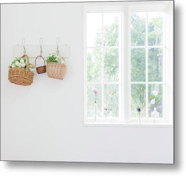 Flowers In Baskets On Wall Metal Print by Bloom Image