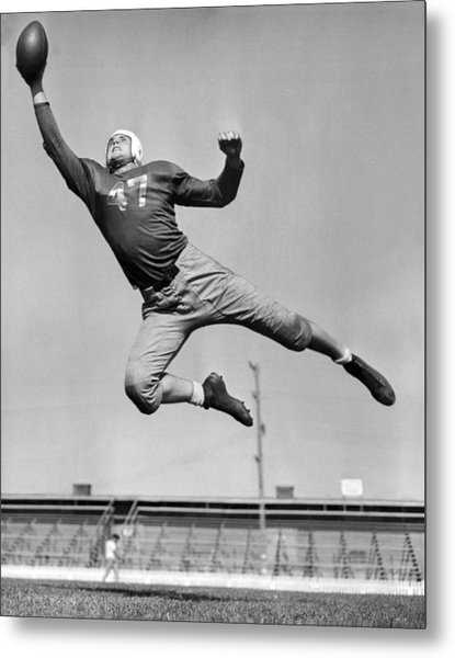 Football Player Catching Pass Metal Print