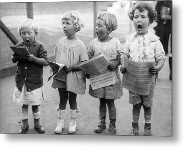 Four Young Children Singing Metal Print