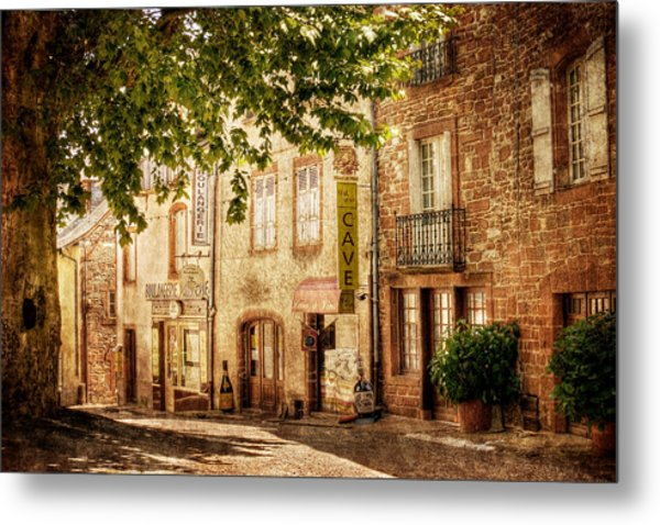 Metal Print featuring the photograph French Village Street / Meyssac by Barry O Carroll