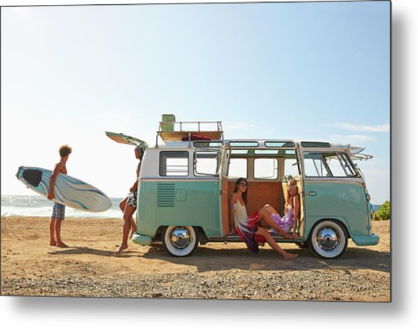Friends With Van Relaxing On Beach Metal Print by Colin Anderson Productions Pty Ltd