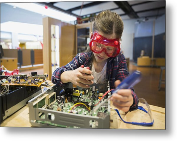 Girl Goggles Assembling Electronics Circuit At Science Center Metal Print by Hero Images