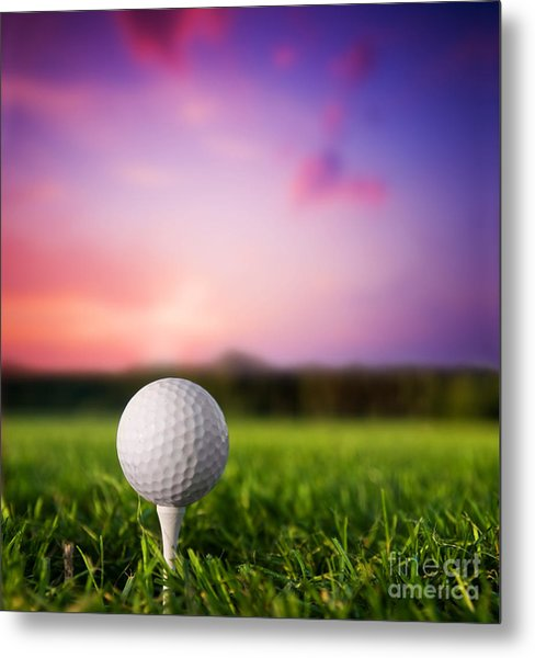 Golf Ball On Tee At Sunset Metal Print