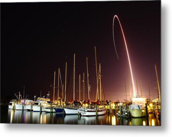 Gps Launch Over The Marina Metal Print by John Moss