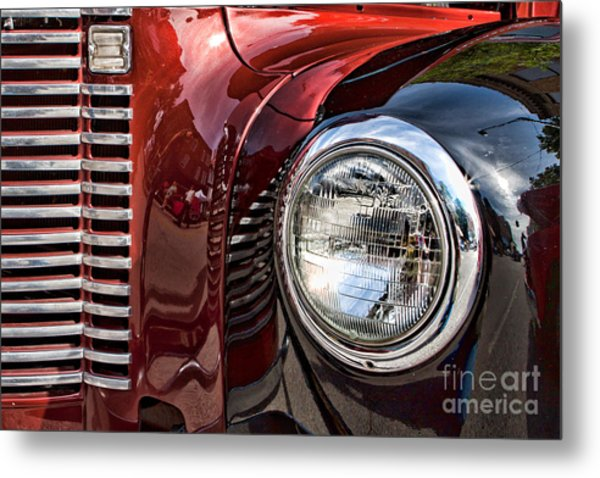 Grill And Headlamp Metal Print by Lawrence Burry