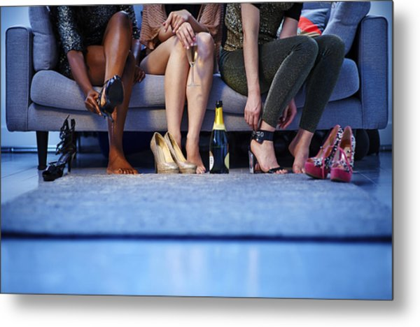 Group Of Women Putting On Heels Before Night Out Metal Print by Mike Harrington