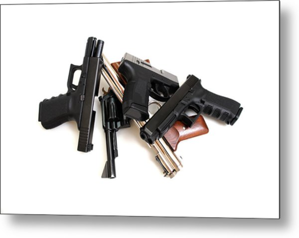 Handgun Collection Metal Print by Don Bendickson