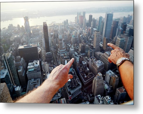 Hands Pointing At City As Seen From Metal Print by Chris Tobin