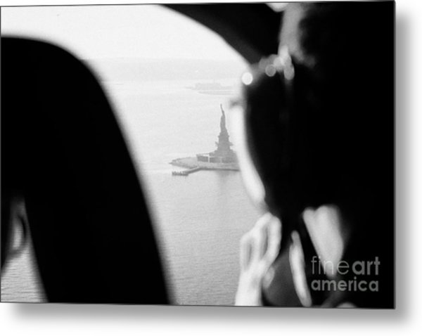 Helicopter  Flies Over Statue Of Liberty As Seen Through The Plexiglas New York Metal Print by Joe Fox