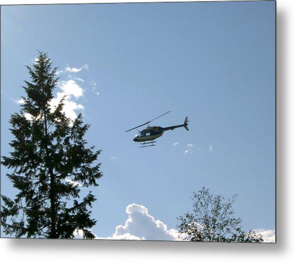 Helicopter Misses Tree Metal Print by Mavis Reid Nugent