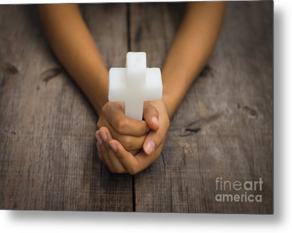 Holding A Religious Cross Metal Print