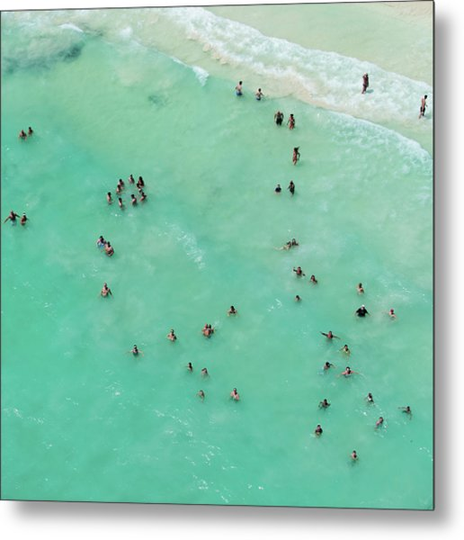 Holiday Makers Cooling Off In The Sea Metal Print