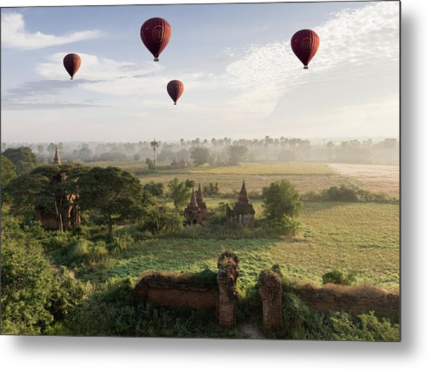 Hot Air Balloons Flying Over Ancient Metal Print by Martin Puddy