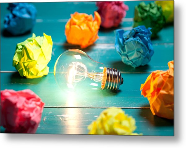 Incandescent Bulb And Colorful Notes On Turquoise Wooden Table Metal Print by Xxmmxx
